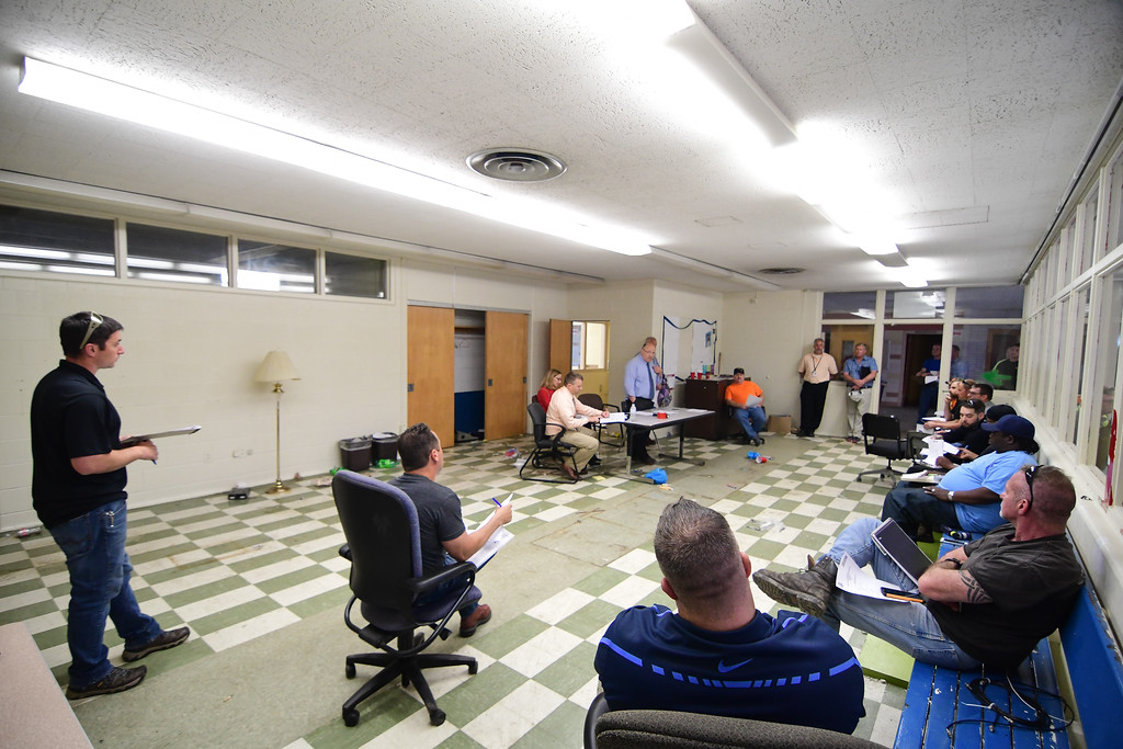 . Eric Bonzar�The Morning Journal<br> On May 17, 2018, contractors were led through the dilapidated interior of the former Southview High School, giving them an inside look at the task at hand. Come May 30, contractors will submit their bids and one will be selected to raze the structure. Once the land is cleared, CEO David Hardy Jr. has said the site could potentially become new space for athletic and recreational facilities.