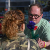 "Eric Bonzar—The Morning Journal<br /> Keith ""The Magic Man"" Heidenreich makes a balloon rose during Vermilion's 11th annual 3rd Thursday: Music Flowers and a Sunset event, May 19, 2016."