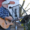 Eric Bonzar—The Morning Journal<br /> Bob Sebastian busks on the front steps of Paradise Salon, during Vermilion's 11th annual 3rd Thursday: Music Flowers and a Sunset event, May 19, 2016.
