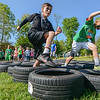 """Eric Bonzar—The Morning Journal<br /> Fourth-graders Brandon Dunstan, 10, (left) and 10-year-old Tony Hutter race through the tires while completing the fourth annual """"Rock the Challenge"""" obstacle course at Holy Trinity School, 2610 Nagel Road, Avon, May 23, 2016."""