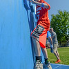 """Eric Bonzar—The Morning Journal<br /> Eleven-year-old Chas Knittel crosses the wall climbing obstacle course while completing the """"Rock the Challenge"""" obstacle course, May 23, 2016."""