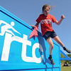 """Eric Bonzar—The Morning Journal<br /> Sixth-grader Mary Gassman, 12, jumps over the finishing wall while completing the fourth annual """"Rock the Challenge"""" obstacle course at Holy Trinity School, 2610 Nagel Road, Avon, May 23, 2016."""