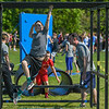 """Eric Bonzar—The Morning Journal<br /> Fifth-grader Gavin Crocker, 11, crosses over the monkey bars while completing the fourth annual """"Rock the Challenge"""" obstacle course at Holy Trinity School, 2610 Nagel Road, Avon, May 23, 2016."""