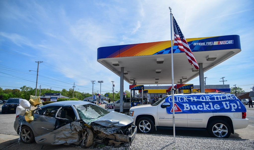 . Eric Bonzar�The Morning Journal<br> The Lorain County Safe Community Coalition held its National Click It or Ticket campaign kick-off, May 17, 2018, at Ali\'s Sunoco, 979 N. Leavitt  Road, in Amherst. during the event, representatives unveiled new gas pump toppers to raise seat belt awareness, and 17-year-old Lorain County Community College student Brandi Cobb shared her story on how wearing a seat belt saved her life when she was involved in a head-on collision in 2017.