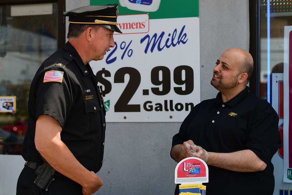 . Eric Bonzar�The Morning Journal<br> Store Owner Ali Mohammad speaks with Amherst police Chief Joseph Kucirek during the Lorain County Safe Community Coalition\'s National Click It or Ticket campaign kick-off, May 17, 2018, held at Ali\'s Sunoco, 979 N. Leavitt  Road, in Amherst.