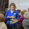 "Eric Bonzar—The Morning Journal<br /> Firelands High School senior Gianna Suglia, 18, clears tables as guests mingle during the ""Lunch and a Show"" event held at South Amherst Middle School, March 28, 2017. The afternoon event provided an opportunity for students to interact with seniors within the community, by offering a luncheon and a performance of ""Princess Whatsername"" by the seventh and eighth grade choirs."