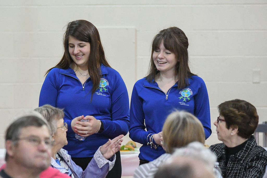 ". Eric Bonzar�The Morning Journal Firelands High School juniors Olivia Novak, left, and Abby Perry, both 17, mingle with guests during the ""Lunch and a Show\"" event held at South Amherst Middle School, March 28, 2017. The afternoon event provided an opportunity for students to interact with seniors within the community, by offering a luncheon and a performance of \""Princess Whatsername\"" by the seventh and eighth grade choirs."