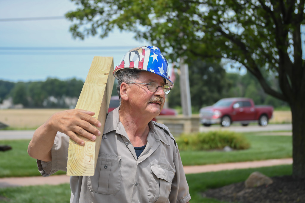 . Eric Bonzar�The Morning Journal Army veteran Joe Horvath, Silver Star recipient and 2017 Veteran of the Year, helps with the construction of the Vietnam Veterans Memorial of Lorain County pavilion, July 26, 2017.