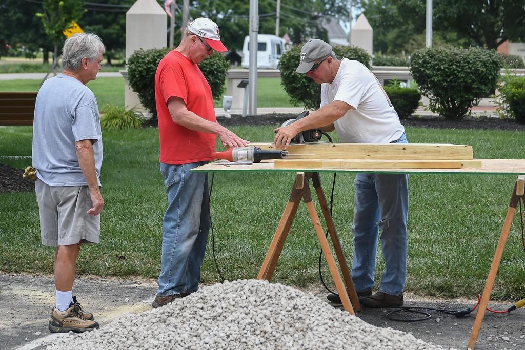 . Eric Bonzar�The Morning Journal Military veterans and volunteers erect the Vietnam Veterans Memorial of Lorain County pavilion, July 26, 2017.