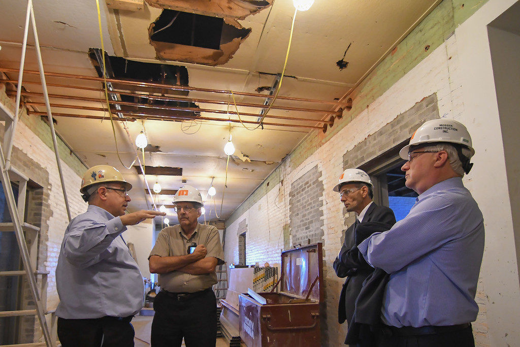 . Eric Bonzar�The Morning Journal From left: Project architect Ron Cocco gives an update on the progress of the historical Lorain County Courthouse renovation project, as Lorain County Historical Society Executive Director William Bird, and Lorain County Commissioners Ted Kalo and Matt Lundy tour the facility, July 26, 2017.