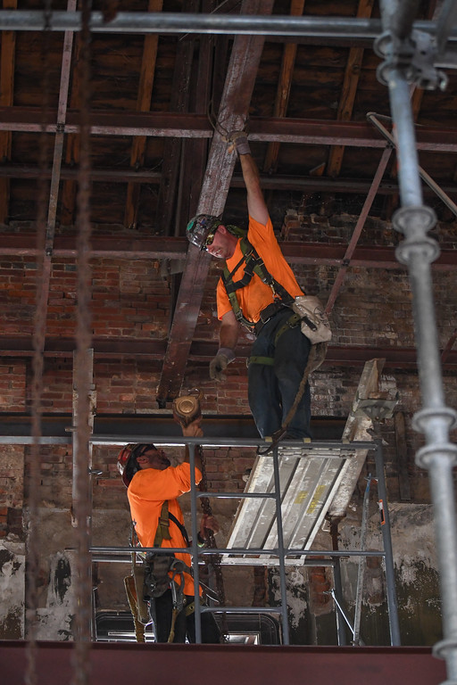. Eric Bonzar�The Morning Journal Construction workers install steel I-beams to expand space on the third floor of the historic Lorain County Courthouse, July 26, 2017.