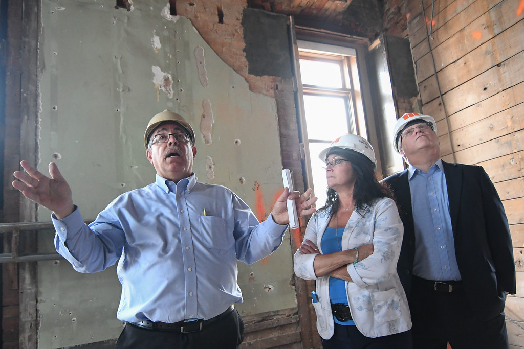 . Eric Bonzar�The Morning Journal From left: Project architect Ron Cocco gives an update on the progress of the historical Lorain County Courthouse renovation project, as Lorain County Commissioners Lori Kokoski and Matt Lundy tour the facility, July 26, 2017.