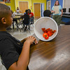 Eric Bonzar—The Morning Journal<br /> Twelve-year-old Andrew Cruz guards his tomato haul while listening to the benefits of eating them, July, 27, 2016.
