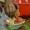 "Eric Bonzar—The Morning Journal<br /> Kids of the Boys and Girls Clubs of Lorain County's Westview Terrace Unit enjoy the vegetables of their labor with fresh salsa made with tomatoes picked from the ""Grow With Me"" garden, July, 27, 2016."