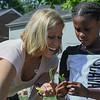 "Eric Bonzar—The Morning Journal<br /> Amy Basinski, human resources manager for Symrise, and Chrissy Castro, 12, pick snap beans  from the Boys and Girls Clubs of Lorain County Westview Terrace Unit's ""Grow With Me"" garden, July, 27, 2016."