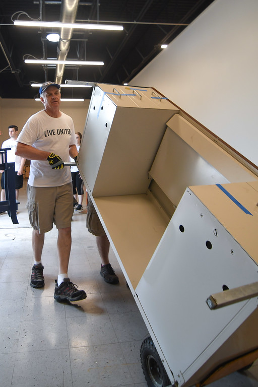. Eric Bonzar�The Morning Journal Executive Director William Harper moves office furniture into the United Way of Greater Lorain County\'s new 642 Broadway Ave. office space, July 27, 2017.