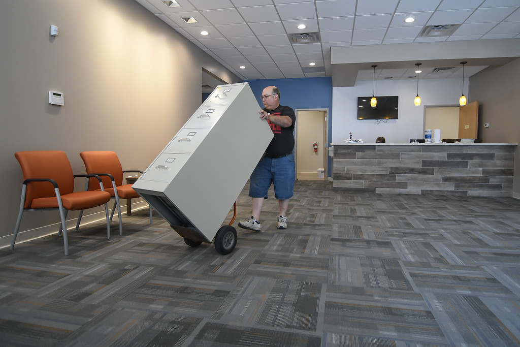 . Eric Bonzar�The Morning Journal Volunteer Dan Thompson�father of Alyssa Thompson Director of Programs, Lorain County Volunteer Connection�moves filing cabinets through the reception area of United Way of Greater Lorain County\'s new 642 Broadway Ave. office space, July 27, 2017.