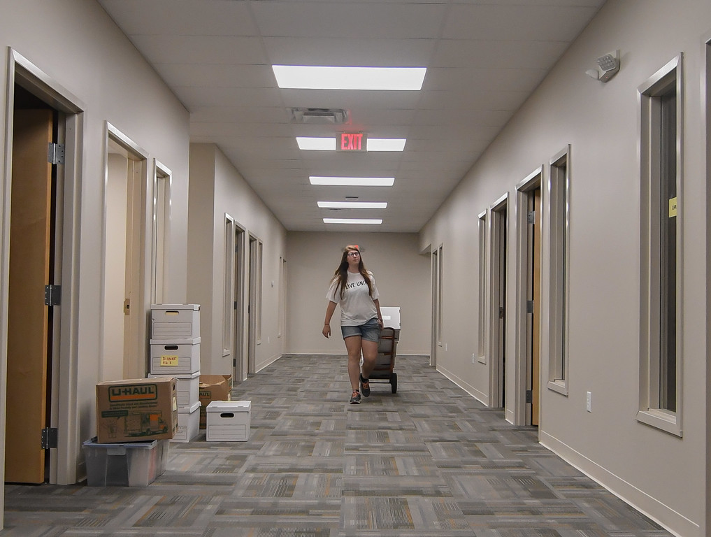 . Eric Bonzar�The Morning Journal Twenty-year-old AmeriCorps volunteer Felicia Densmore carts office documents through the hallway of the United Way of Greater Lorain County\'s new 642 Broadway Ave. office space, July 27, 2017.