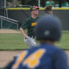 Eric Bonzar—The Morning Journal<br /> Saint Ignatius' John Criscione (14) watches from third base as Amherst's Jake Hart fields a one hopper, July 28, 2017.