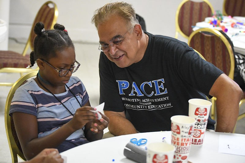 "Eric Bonzar—The Morning Journal<br /> Michael Ferrer, vice president of youth development programs, checks in on a participant of PACE Foundations' ""Summer of Innovation"" summer camp, Aug. 31, 2017."