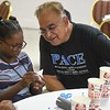 """Eric Bonzar—The Morning Journal<br /> Michael Ferrer, vice president of youth development programs, checks in on a participant of PACE Foundations' """"Summer of Innovation"""" summer camp, Aug. 31, 2017."""
