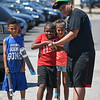 """Eric Bonzar—The Morning Journal<br /> Camp Counselor Gadier Garcia, right, helps 8-year-old Javon Jackson launch the rocket he made during PACE Foundations' """"Summer of Innovation"""" summer camp, Aug. 31, 2017."""
