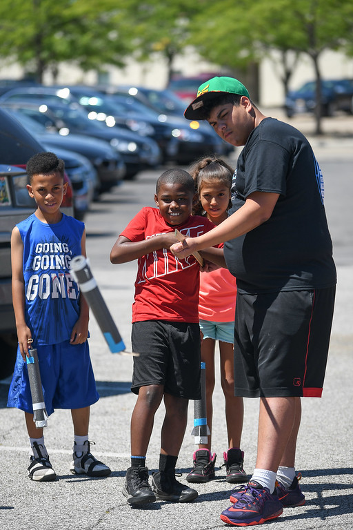 . Eric Bonzar�The Morning Journal Camp Counselor Gadier Garcia, right, helps 8-year-old Javon Jackson launch the rocket he made during PACE Foundations\' �Summer of Innovation� summer camp, Aug. 31, 2017.