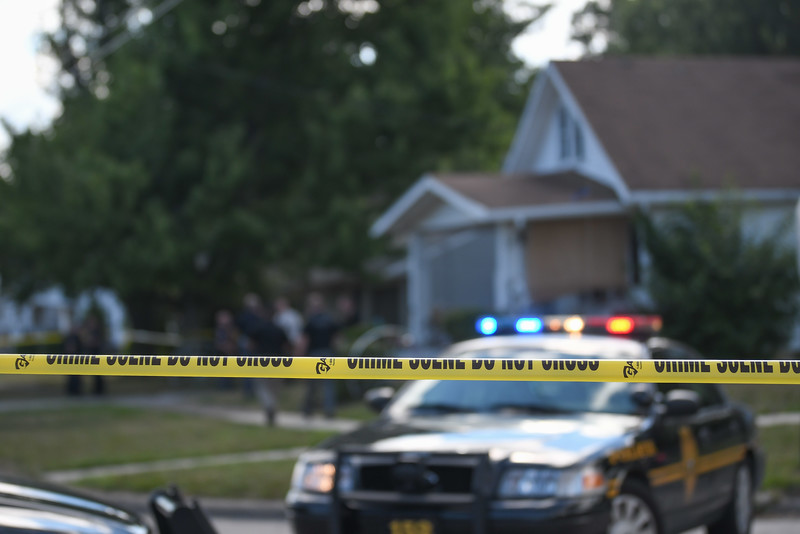 Eric Bonzar—The Morning Journal<br /> Lorain police investigate a homicide on the 800 block of West 23rd Street, Aug. 2, 2016. Police are searching for answers in the death of 53-year-old Johnnie Whitfield, who was found dead in his home.