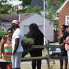 Eric Bonzar—The Morning Journal<br /> Friends and family of 53-year-old Johnnie Whitfield gather across the street from his West 23rd Street home after receiving word of his death, Aug. 2, 2016.