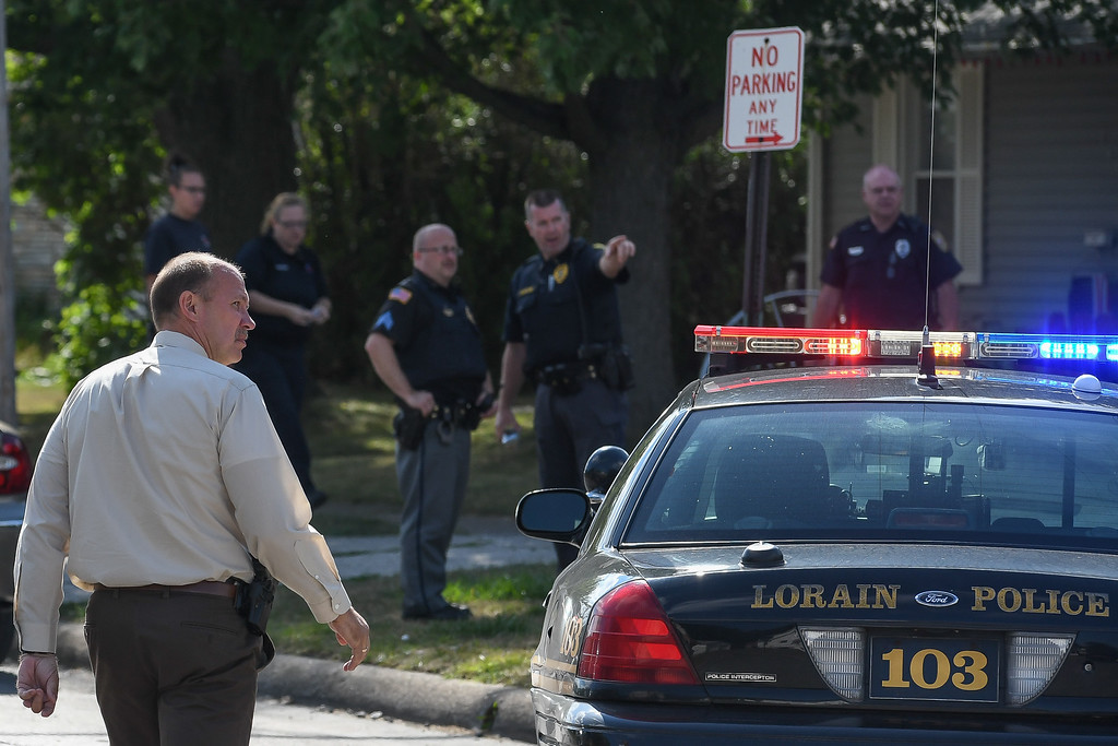. Eric Bonzar�The Morning Journal Lorain police investigate a homicide on the 800 block of West 23rd Street, Aug. 2, 2016. Police are searching for answers in the death of 53-year-old Johnnie Whitfield, who was found dead in his home.
