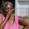 Eric Bonzar—The Morning Journal<br /> A woman on scene fights back tears after hearing the news of Johnnie Whitfield's death, Aug. 2, 2016.