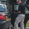Eric Bonzar—The Morning Journal<br /> Lorain police Sgt. Dennis Camarillo questions a woman at the scene of a homicide investigation, Aug. 2, 2016.