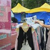 Eric Bonzar—The Morning Journal<br /> Marissa Zimmerman, owner of The Vintage Valet LLC Mobile Boutique, rearranges a rack of her vintage wares, for sale, during The Vermilion Beach Market, at Sherod Park, Aug. 4, 2017.