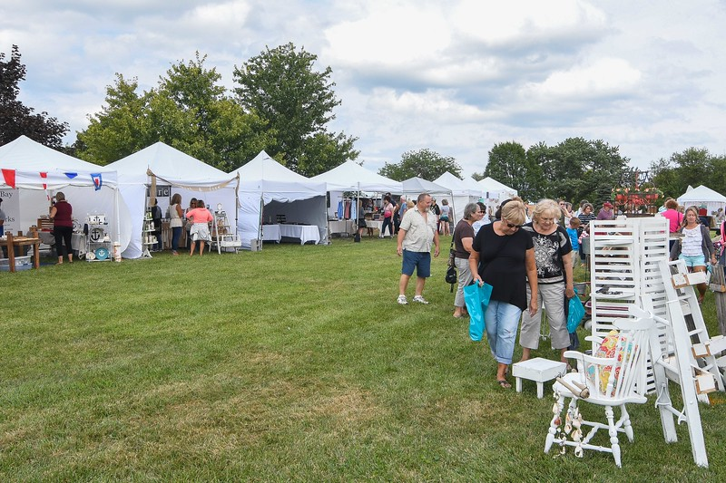 Eric Bonzar—The Morning Journal<br /> Shoppers flocked to Sherod Park, where some 60 vendors were on hand for Vermilion's first annual Vermilion Beach Market, Aug. 4, 2017. The event continues, from 9 a.m. to 4 p.m., Aug. 5.