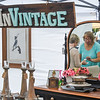 Eric Bonzar—The Morning Journal<br /> Melissa Foldesi, co-owner of ReInVintage Furniture and Home Décor, passes along her business card to a potential buyer, during The Vermilion Beach Market, at Sherod Park, Aug. 4, 2017. Foldesi and her husband Les were one of 60 vendors attending the first annual event, which continues from 9 a.m. to 4 p.m., Aug. 5.