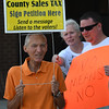 Eric Bonzar—The Morning Journal<br /> Al Penzes, of Elyria, protests outside of the Lorain County Administration Building, Aug. 9, 2017. Penzes and fellow members of the Repeal the Sales Tax Committee protested for thirty minutes, prior to the Lorain County Commissioners' weekly meeting.