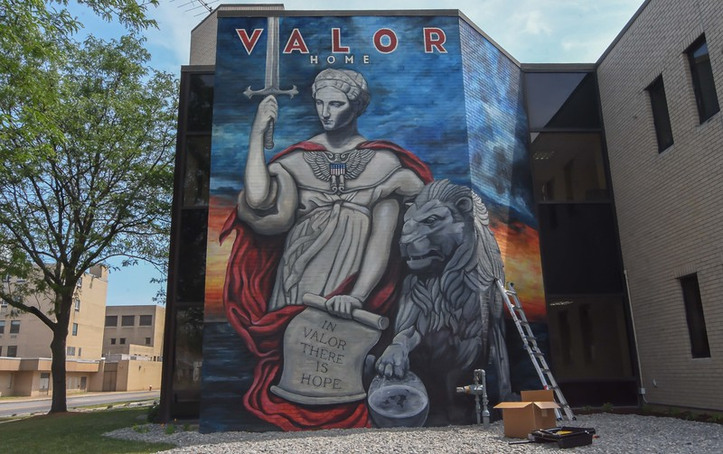 Eric Bonzar—The Morning Journal<br /> The Valor Home mural prior to local artists Mike Sekletar, and Brian Goodwin, of Amherst, added the finishing touch to the Valor Home mural: a coat of clear to protect the artists' work from the elements and potential vandals, Aug. 10, 2017. The pair of life-long friends spent roughly two months' time painting the western outside wall of the 221 W. 21st St. transitional facility to honor local military veterans.