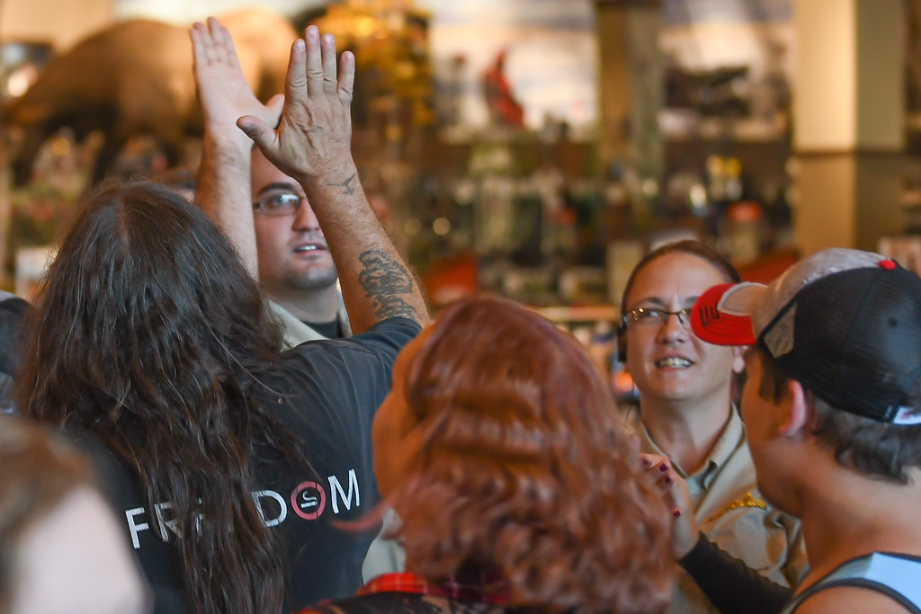 . Eric Bonzar�The Morning Journal Cabela\'s employees high-five and cheer on customers as they make their way into Cabela\'s new Avon store, Aug. 11, 2016.