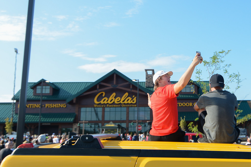 . Eric Bonzar�The Morning Journal Nineteen-year-old Keane Moyer takes a selfie while he and his friend Aaren Lisi, 19, sit atop of their vehicle while waiting for the grand opening of the Avon Cabela\'s, Aug. 11, 2016. Moyer said he and Lisi drove from Westerville, Ohio for the opening, before heading to the Blossom Music Center, in Cuyahoga Falls, for the Luke Bryan concert later that evening.