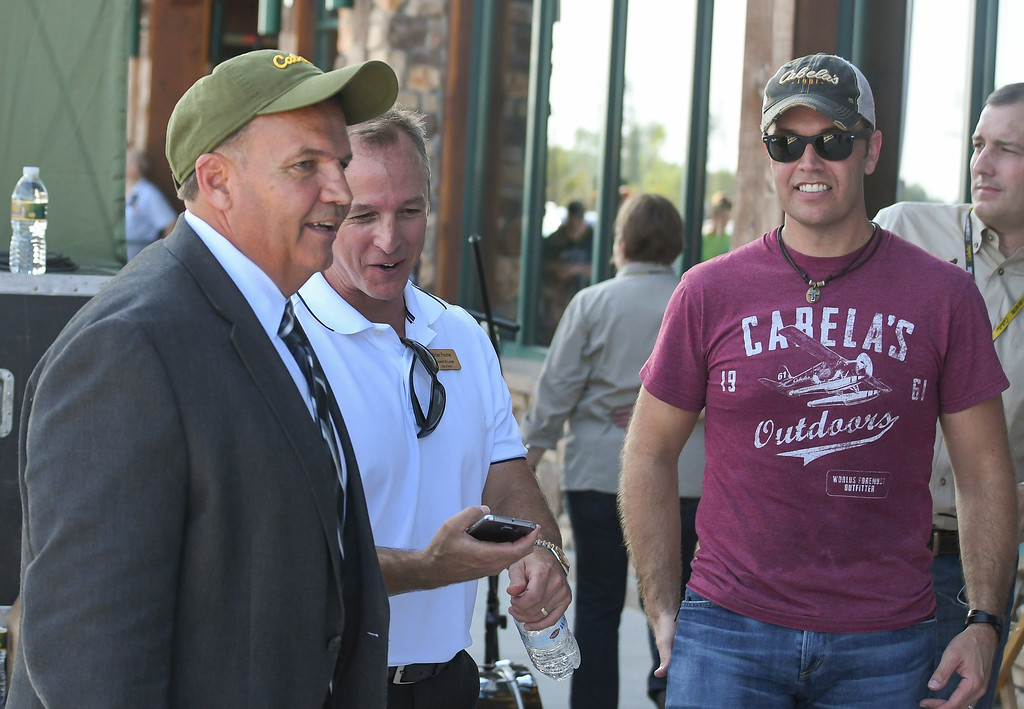 . Eric Bonzar�The Morning Journal Avon Mayor Bryan Jensen, left,  Avon Councilman-at-Large Brian Fischer, center, and singer-songwriter Lucas Hoge mingle during Cabela\'s grand opening of its Avon store, Aug. 11, 2016.