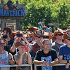 """Eric Bonzar—The Morning Journal<br /> The crowd waits anxiously to hear the announcement of Cedar Point's new hyper-hybrid coaster """"Steel Vengeance,"""" during the amusement park's Frontier Town Hootenanny! event, Aug. 16, 2017."""