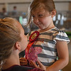 Eric Bonzar—The Morning Journal<br /> Four-year-old Eliana Collins, of Vermilion, makes silly faces after placing second in the fowl race, at the Lorain County Fair, Aug. 26, 2016.