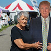 Eric Bonzar—The Morning Journal<br /> Betty Goad, of Elyria, poses with a cardboard cutout of Republican presidential hopeful Donald Trump at the Lorain County Fair, Aug. 26, 2016.