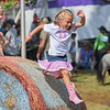Eric Bonzar—The Morning Journal<br /> Seven-year-old Kendyl Gregor, of Elyria, jumps from a hay bail as her 5-year-old sister Karleigh looks on, at the Lorain County Fair, Aug. 26, 2016.