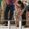 """Eric Bonzar—The Morning Journal<br /> Four-year-old Eliana Collins, of Vermilion, and """"Zoey"""" compete in the fowl race with the assistance of her sister Bella Collins, 11, at the Lorain County Fair, Aug. 26, 2016."""