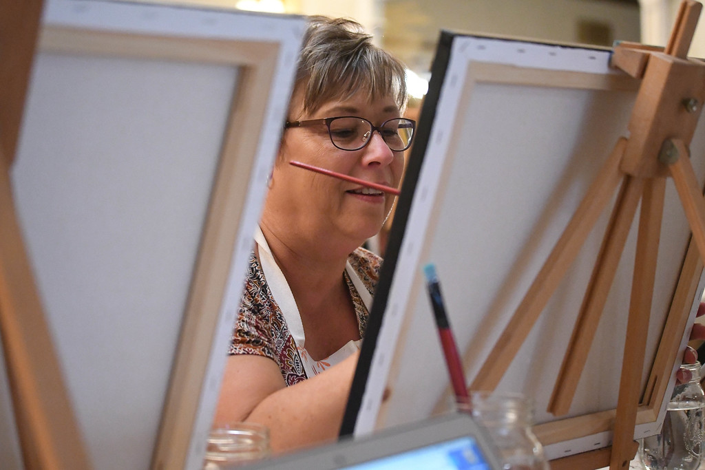 . Eric Bonzar�The Morning Journal Sharon Salkiewicz, of Lorain, paints the Lorain Lighthouse during Whet Your Palette\'s paint night at the Lorain Palace Theater, Aug. 24, 2017.