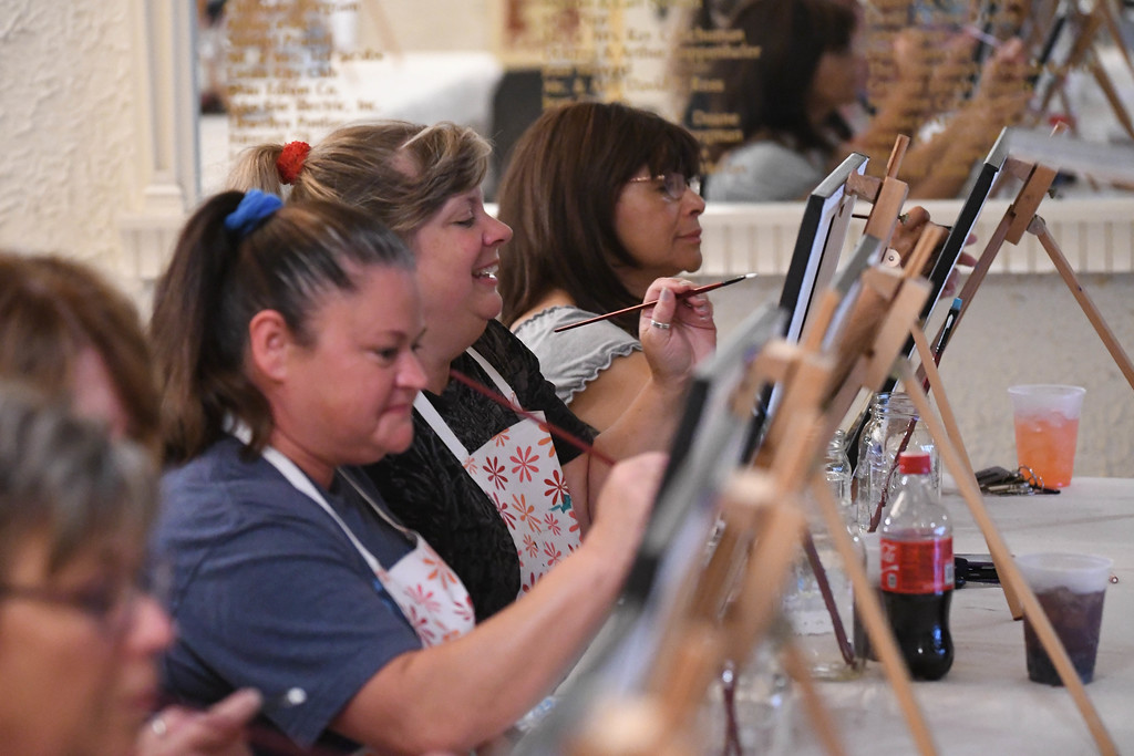 . Eric Bonzar�The Morning Journal Guests came to the Lorain Palace Theater where they celebrated the 100th anniversary of the Lorain Lighthouse with wine and painting,  with Whet Your Palette owners Bobbi and Jim White--and artist Chad DiFranco, Aug. 24, 2017.