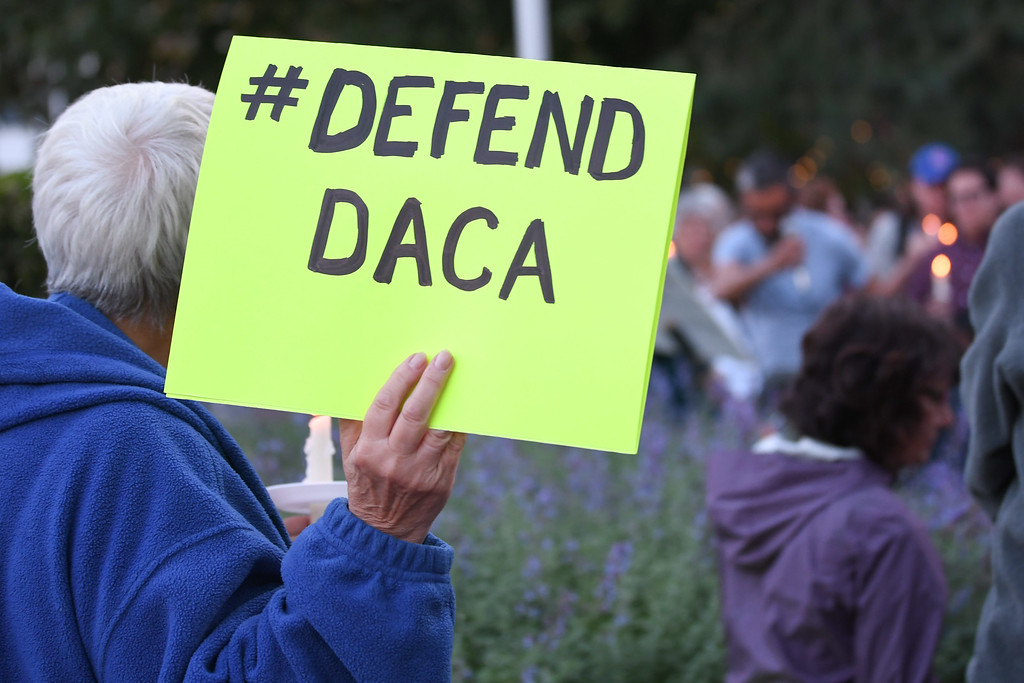 . Eric Bonzar�The Morning Journal Many gathered on Oberlin\'s Tappan Square to protest President Donald Trump\'s recension of former President Barack Obama\'s Deferred Action for Childhood Arrivals (DACA) program, Sept. 5, 2017.