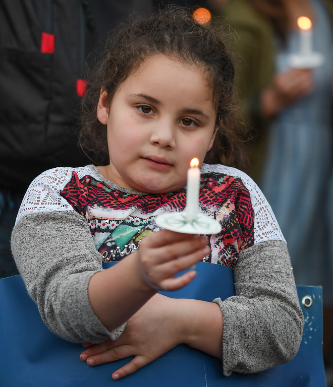 . Eric Bonzar�The Morning Journal Seven-year-old Emely Leija, of Lorain, watches her candle burn as she and many others gather on Oberlin\'s Tappan Square to protest President Donald Trump\'s recension of former President Barack Obama\'s Deferred Action for Childhood Arrivals (DACA) program, Sept. 5, 2017.