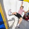 "Eric Bonzar—The Morning Journal<br /> Thirteen-year-old Riley Romes, 13, tumbles his way over the top of an inflatable obstacle course, during the United Way of Greater Lorain County's ""United We Sweat Field Day"" event held at the high school's Ross Field, Sept. 13, 2016."